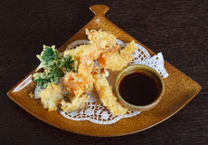 Tempura shrimps (deep fried shrimps) with soy sauce. Decorating dish of Japanese and Asian cuisine. Close up top view Royalty Free Stock Photography