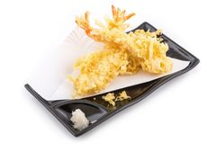 Tempura Shrimps. Japanese Cuisine - Tempura Shrimps Deep Fried Shrimps in the black plate isolated on white background royalty free stock image