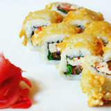 Tempura Sushi roll with cream cheese, eel and tobiko Royalty Free Stock Images