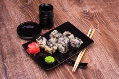 Tempura sushi roll with ginger, soy sauce and chopsticks Stock Images