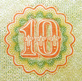 Ten. On the fragment of old banknotes Royalty Free Stock Image