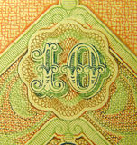 Ten. On the fragment of old banknotes Royalty Free Stock Images