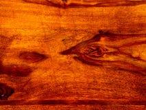 ten akacjowy szalunek, podstrzyżenie z rosewood czerwonym drewnianym tłem fotografia stock