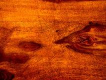 ten akacjowy szalunek, podstrzyżenie z rosewood czerwonym drewnianym tłem obrazy stock