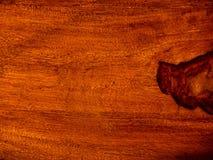 ten akacjowy szalunek, podstrzyżenie z rosewood czerwonym drewnianym tłem zdjęcia royalty free