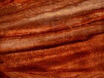 ten akacjowy szalunek, podstrzyżenie z rosewood czerwonym drewnianym tłem zdjęcia stock