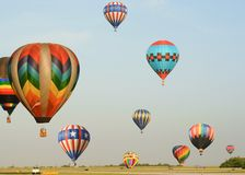 Many Colorful Hot Air Balloons. Rising and falling Royalty Free Stock Images