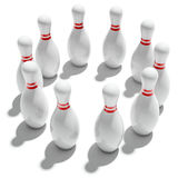 Ten bowling pins in circle. Ten bowling pins on white background Royalty Free Stock Images