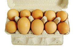 Ten brown eggs. Stock Photo