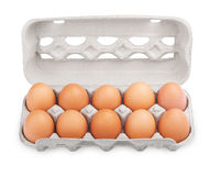 Ten brown eggs in carton package Stock Photos
