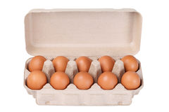 Ten brown eggs in a carton package Stock Photos