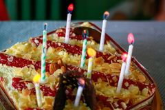 Ten candles on the birthday cake royalty free stock photos