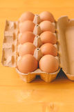 Ten chicken eggs in cardboard box Stock Photography