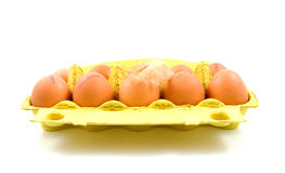 Ten chicken eggs in yellow box Royalty Free Stock Photography