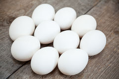 Ten chicken white raw eggs laying on board Royalty Free Stock Image