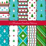 Ten Christmas geometrical seamless patterns in blue, red, green colours with snowmen, snow trees, snowflakes, stars and gifts. Endless texture for wallpaper, web stock illustration