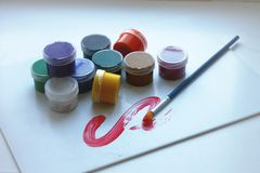Ten colors in paint cans and one brush royalty free illustration