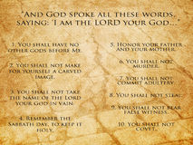 Ten Commandments. The Ten Commandments from the Bible on textured stone background
