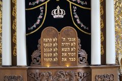 Ten commandments in Hebrew. JERUSALEM - The ancient Hurvah synagogue in the Old City has been renovated with ornate furnishings such as this ark cover with the royalty free stock photo