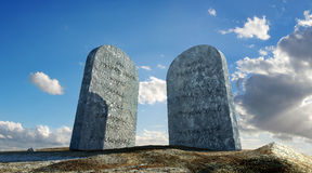 Ten commandments stones, viewed from ground level in dramatic pe. Rspective, with sky and clouds in background Stock Images