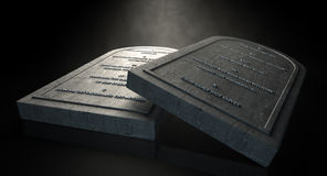 The Ten Commandments. Two representative stone tablets with the ten commandments inscribed on them on an isolated dark ethereal background Royalty Free Stock Photos