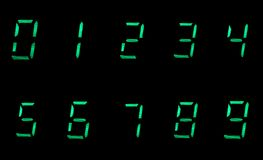 Ten digital numbers in green on black background. Digital numbers in green on black background Royalty Free Stock Photography