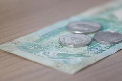 Ten Dirham Note and Coins Stock Images