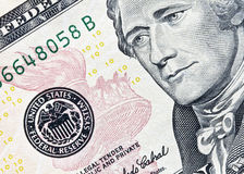 Ten dollar bill focus on federal reserve seal. Closeup of US ten dollar bill showing Hamilton and the federal reserve seal royalty free stock photos