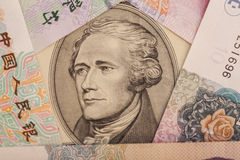 Ten dollar bill surrounded by Chinese Yuan Stock Photography