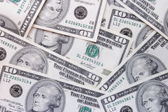 Ten dollar bills. Spread out in a pattern Royalty Free Stock Images