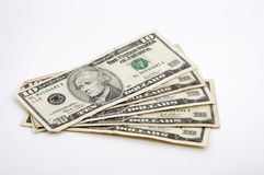 Ten-dollar bills spread out on white Stock Photography