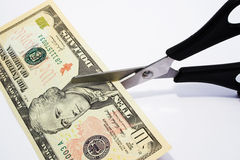 Ten dollar cut. Cutting your money down to size Royalty Free Stock Image