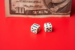 Ten dollar and dices Royalty Free Stock Photo