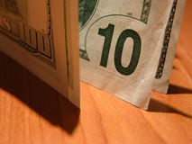 Ten dollars bill ($100 in shade) Royalty Free Stock Photos