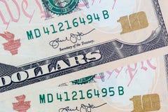 Ten dollars bills close up consecutive serial numbers stock photography