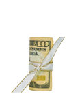 Ten Dollars in Cash Rolled with a Ribbon. A single US Ten Dollar Bill rolled and tied with a white and gold ribbon Royalty Free Stock Photos