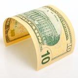 Ten dollars. Curved bill ten dollars on a light plane Royalty Free Stock Photos