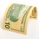 Ten dollars. Curved bill ten dollars on a light plane Stock Image