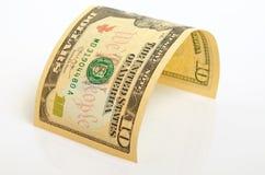 Ten dollars. Curved bill ten dollars on a light plane Royalty Free Stock Photo