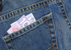 Ten dollars in jeans pocket. Canadian ten dollar bill in back pocket of blue jeans Royalty Free Stock Photography