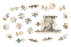 Ten dollars jigsaw. There is a banknote jigsaw in the photo. This banknote is a US ten dollars Stock Photo