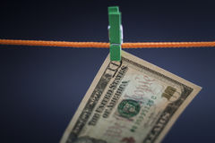 Ten dollars was fixed on a rope with a green clothespin. Drying, background Stock Photos
