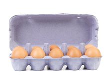 Ten eggs in a blue carton box. Royalty Free Stock Photos