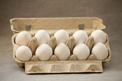 Ten eggs in a box Stock Images