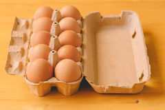 Ten eggs in cardboard box Stock Photography