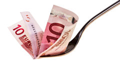 Ten euro banknote and fork. Royalty Free Stock Photos