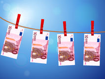 Ten euro banknotes on clothesline Stock Photo