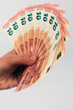 Ten euro banknotes in hand Royalty Free Stock Photo