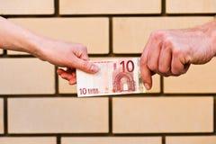 Ten euro in hand Stock Photos
