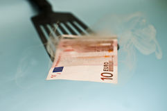 Ten euro steaming bill. Ten euro bill coming out from the bank oven Stock Image